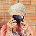 senior resident holding a camera