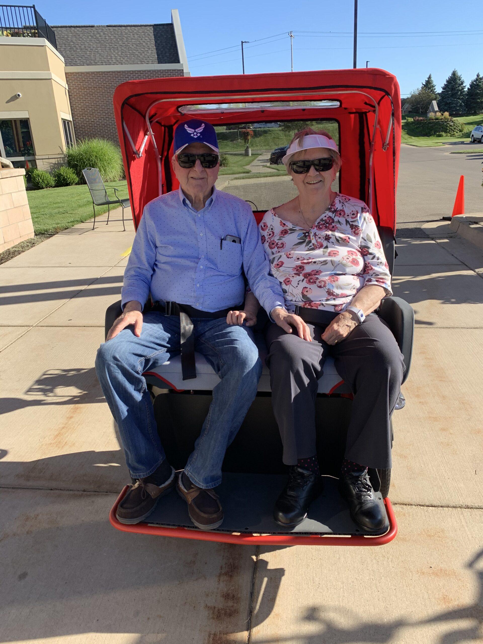 senior couple enjoying a ride in a three-wheeled trishaw