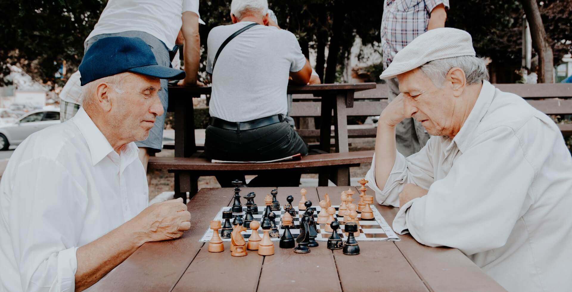 two seniors playing chess